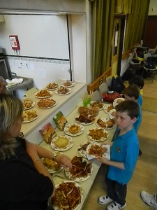 5th Hyde Scout Group enjoy a meal together after visiting the Blue Planet