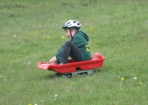 Cubs enjoy Grass Sledging at Group Camp 2012